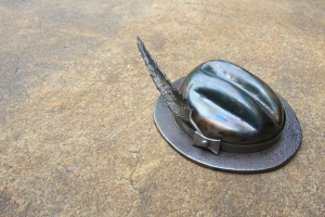 Fedora hat sculpture with feather