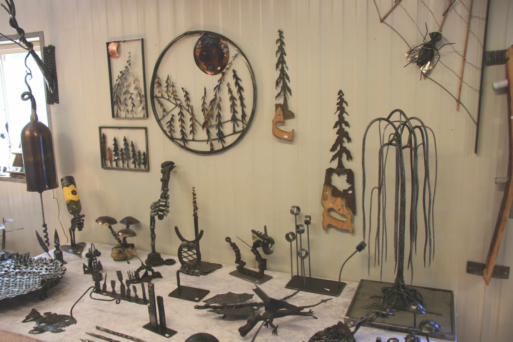 Table and wall full of metal art