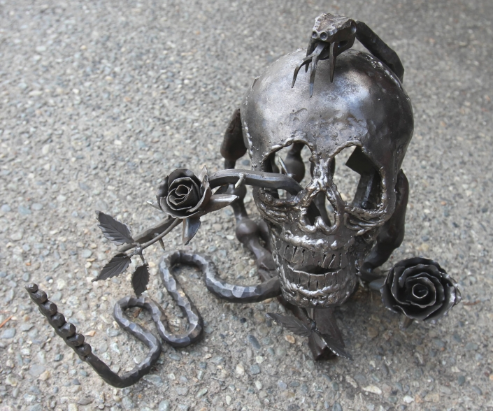 Skull and snake sculpture