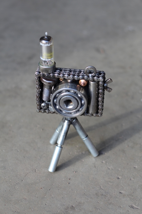 Compact scrap metal camera sculpture
