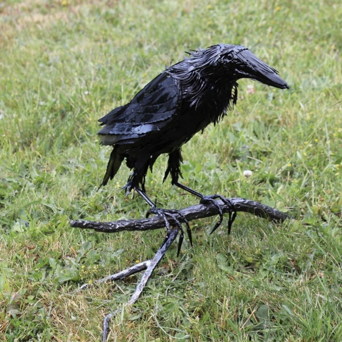 Metal raven on branch