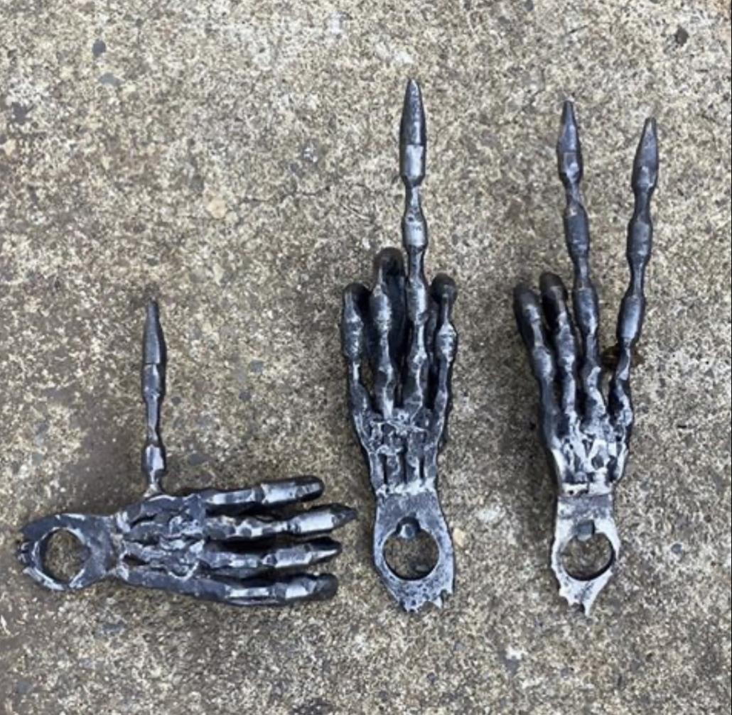 Skeleton hand bottle openers